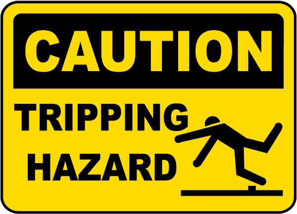 A sign that reads CAUTION Tripping Hazard with an illustration of a person tripping