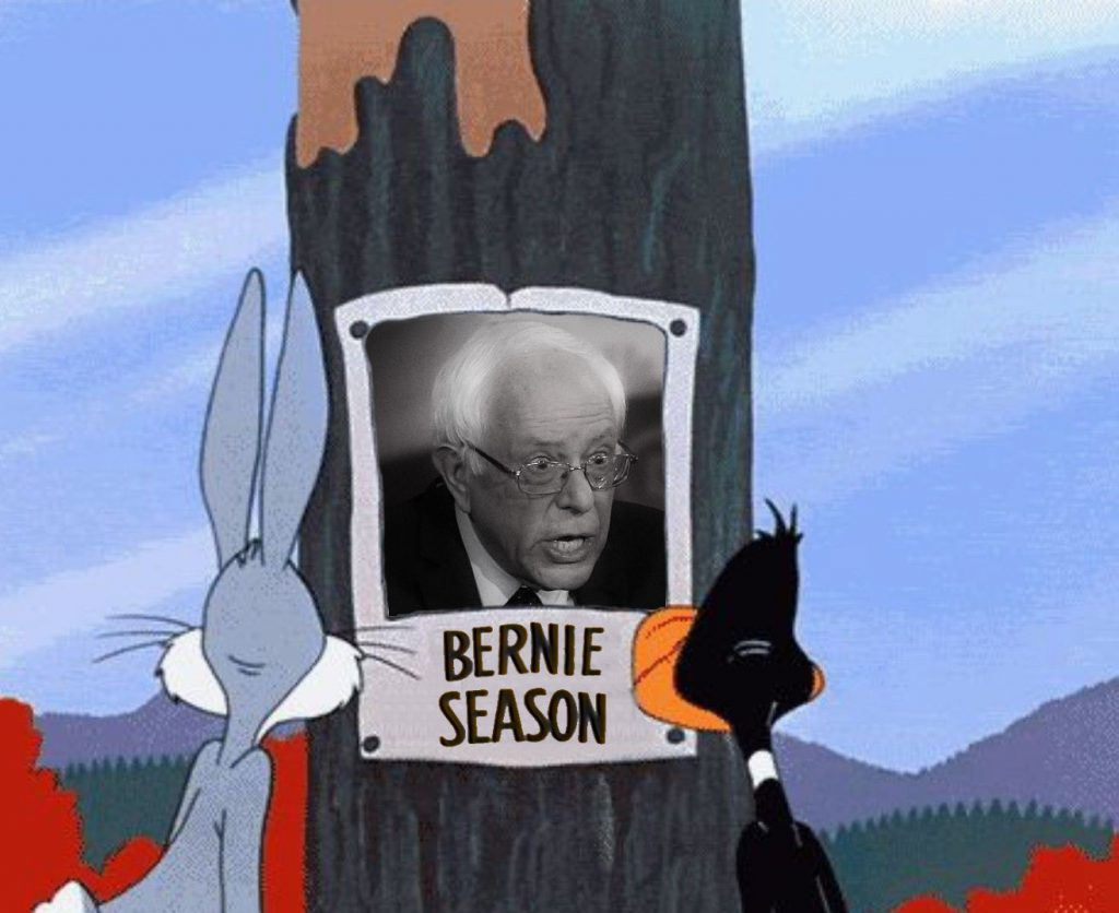 "Bugs Bunny and Daffy Duck staring at a poster of Bernie Sanders labeled ""Bernie Season"""